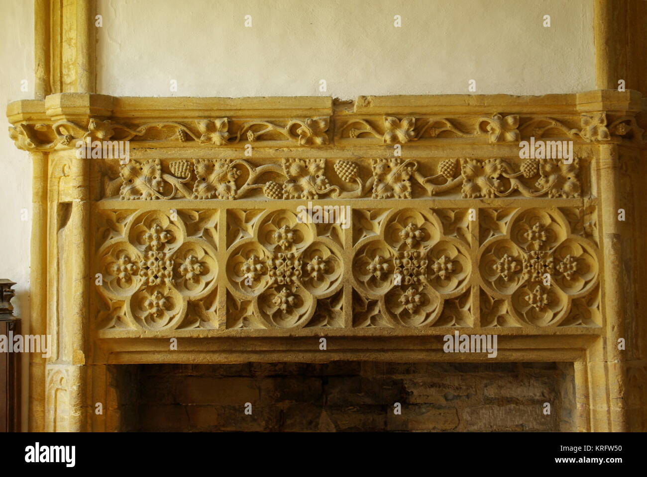 Carved fireplace in Muchelney Abbey, a Grade I listed building in the village of Muchelney, Somerset.      Date: Stock Photo