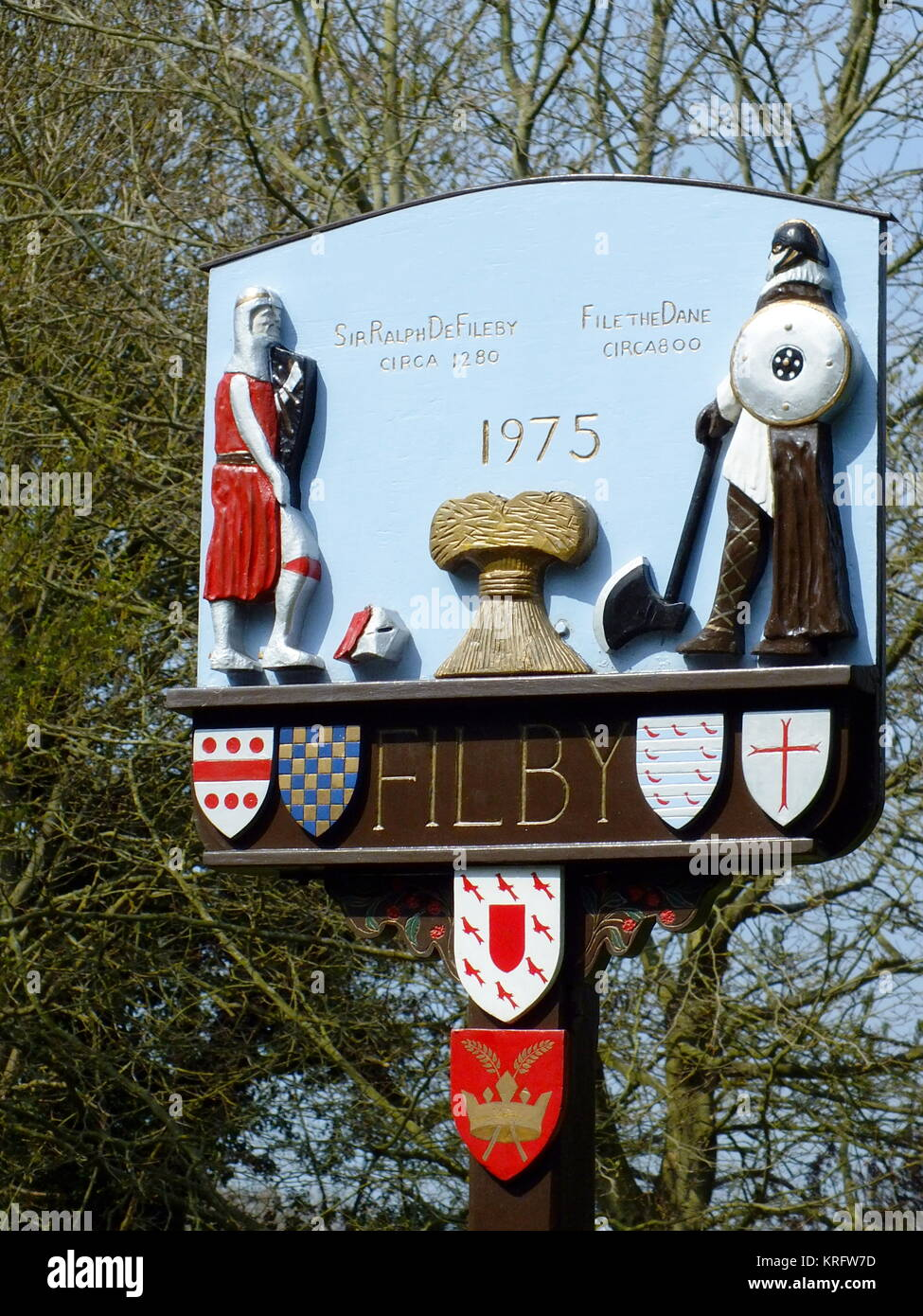 Village sign for Filby, near Great Yarmouth, Norfolk, dated 1975, depicting two historical figures -- File the Dane, - Stock Image
