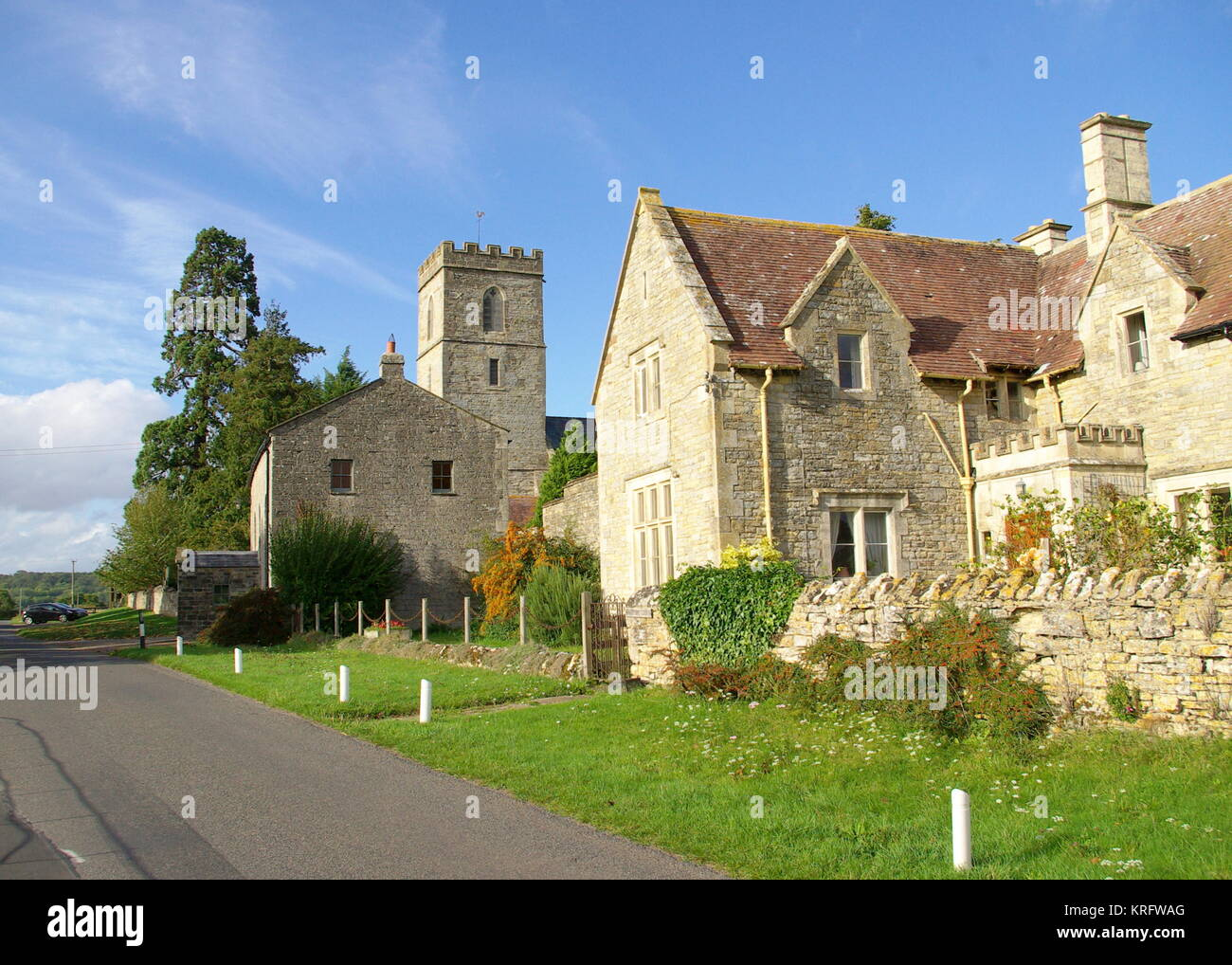 Group of historic buildings in Hartpury, Gloucestershire.  The tower in the middle distance belongs to St Mary's - Stock Image