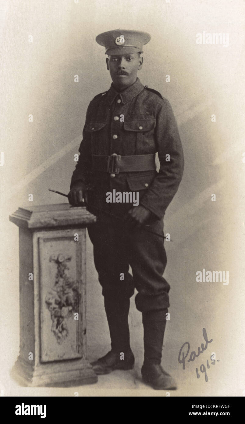 Studio portrait of a black British soldier during the First World War.  His badge cap denotes he is a member of - Stock Image