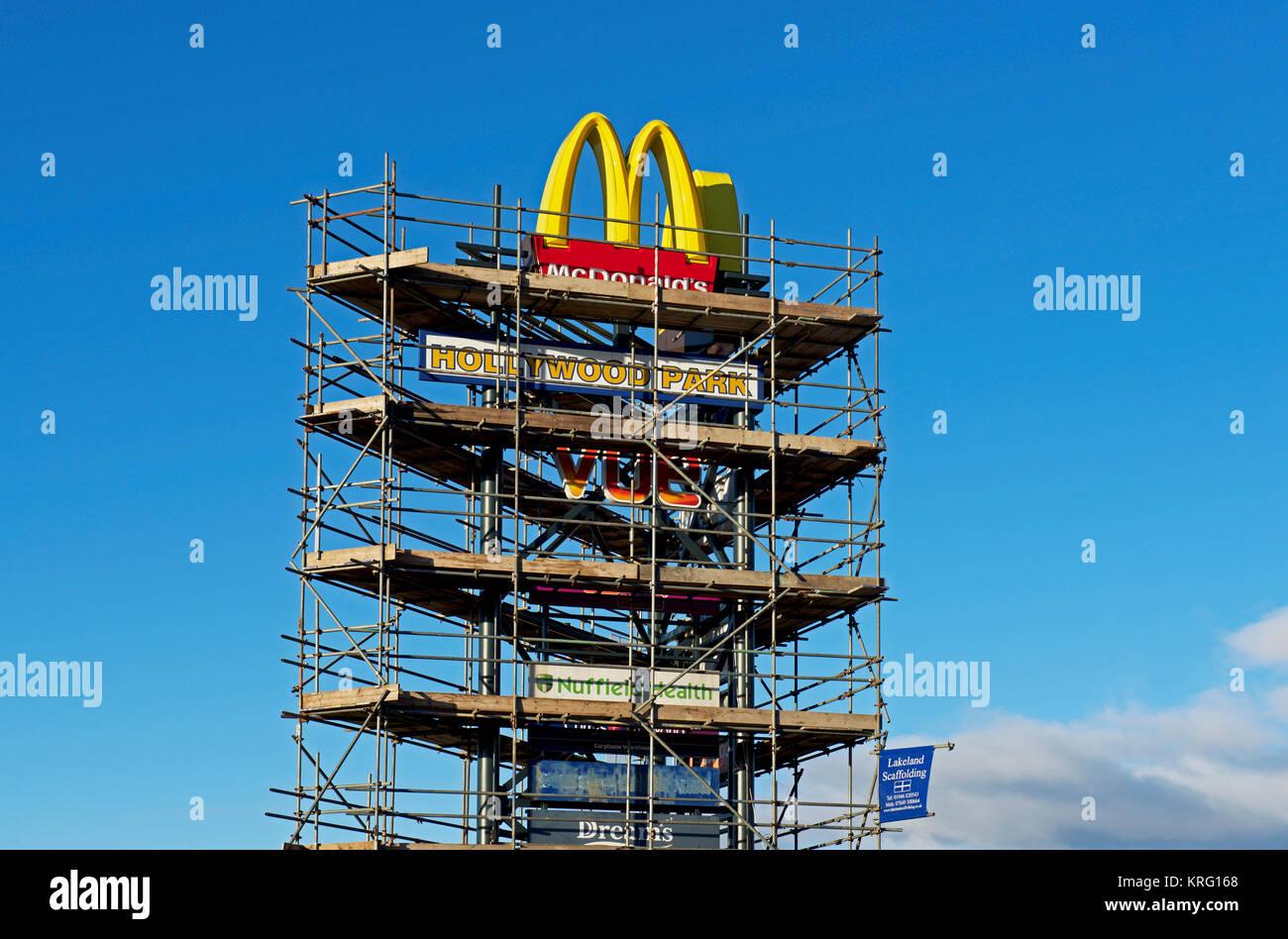 McDonalds logo, and scaffolding, England UK - Stock Image