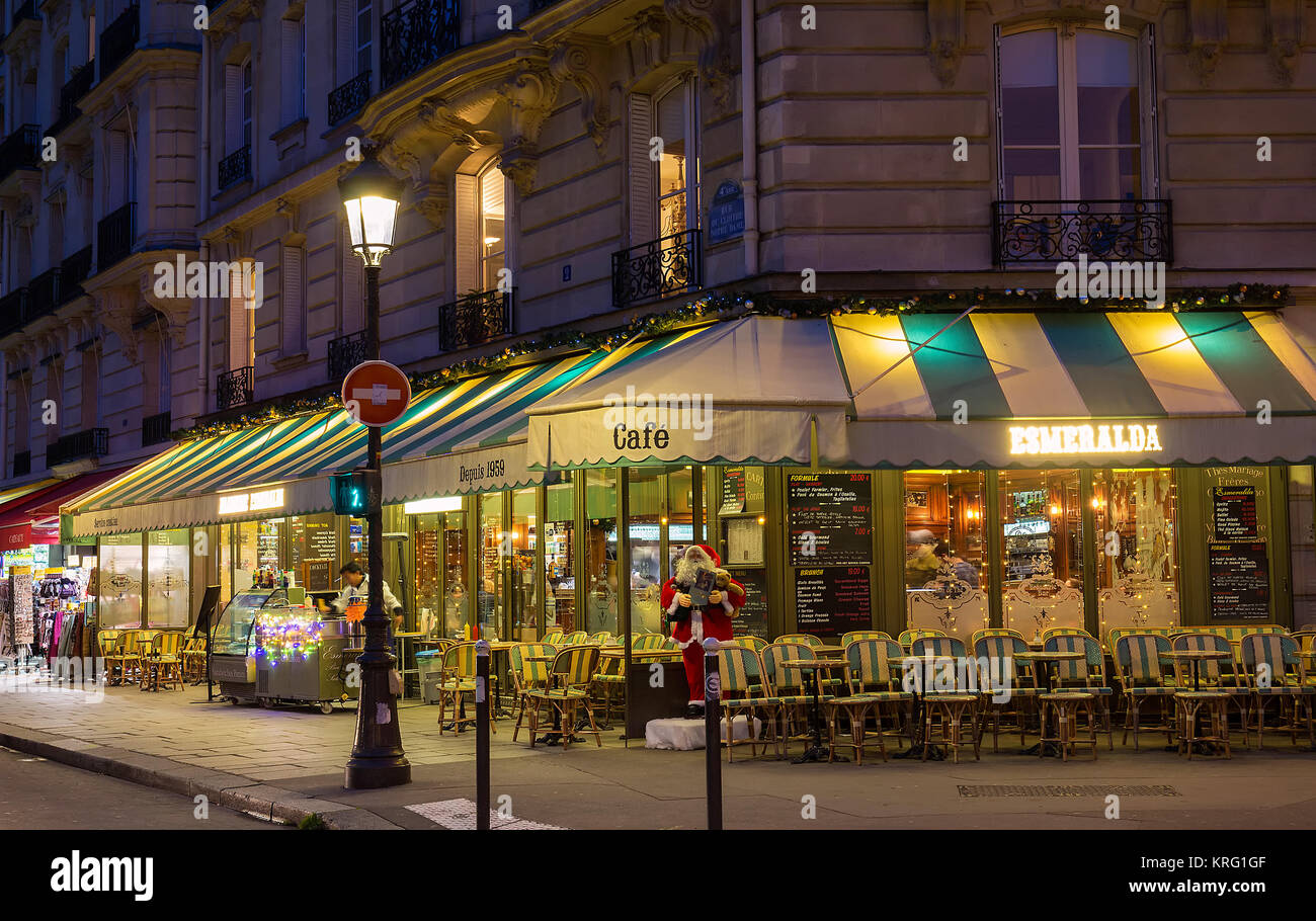 The famous cafe Esmeralda decorated for Christmas located near Notre Dame cathedral in Paris, France. - Stock Image