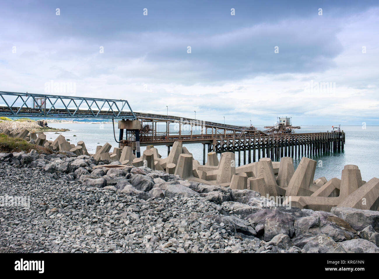 Raynes jetty with sea defence in Llanddulas North Wales UK - Stock Image