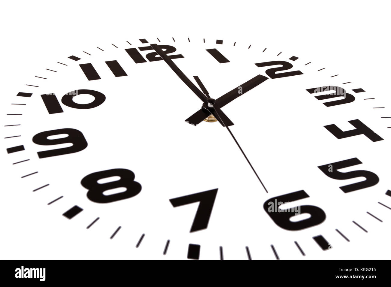 Clock isolated on white marking the two o'clock hour. The main focus is in the hour hand. Stock Photo