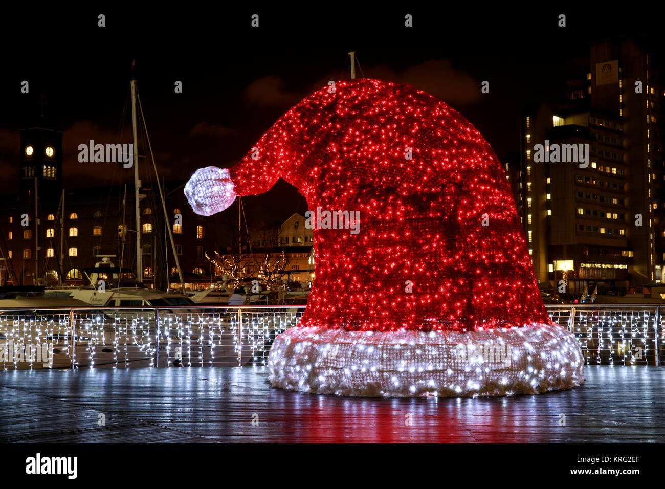Giant illuminated Santa Hat in St. Katharine's Dock, London, England. - Stock Image