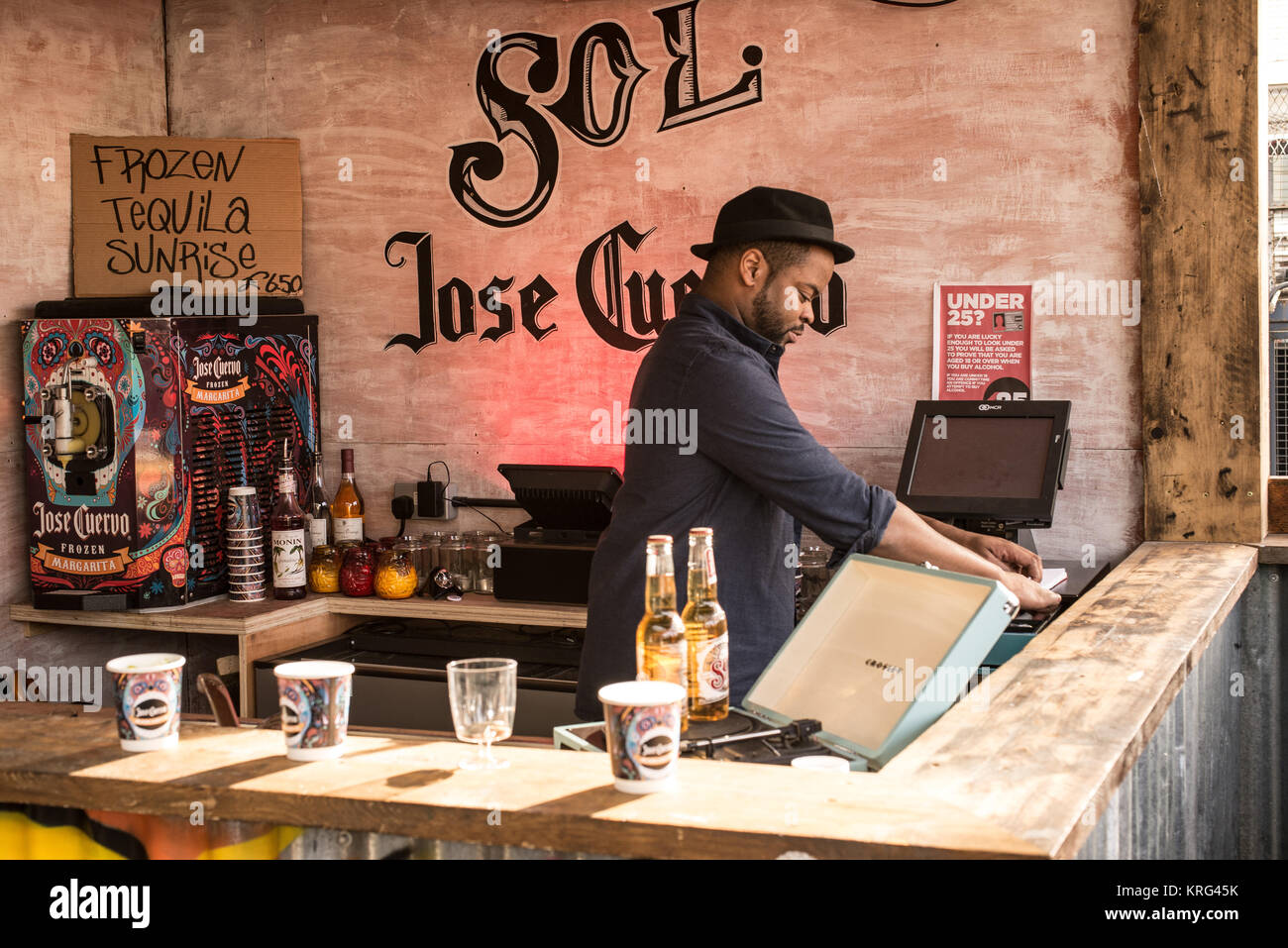 Barman at a food stall selling cocktails at the pop-up street food market venue called Dinerama popular among young - Stock Image
