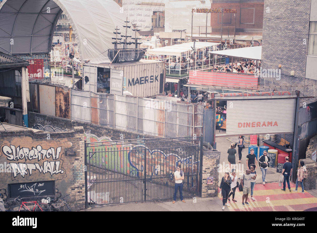 Pop-up street food market venue called Dinerama popular among young trendy people in Shoreditch Yard,19 Great Eastern - Stock Image