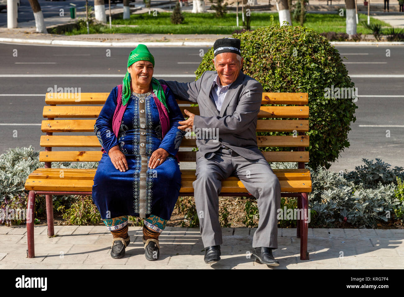 A Senior Uzbek Couple Sitting On A Bench, Bukhara, Uzbekistan Stock Photo