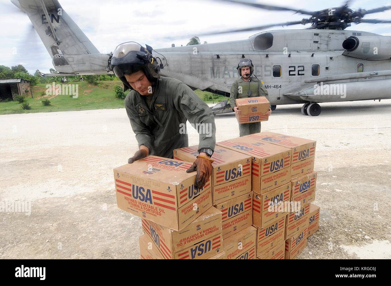 U.S. Marine soldiers unload disaster relief supplies during a humanitarian assistance mission to areas affected - Stock Image
