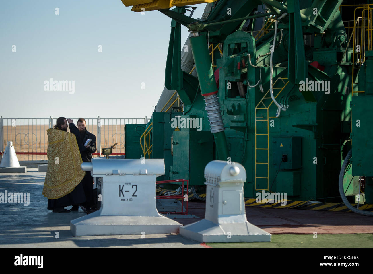 An Orthodox priest blesses the Soyuz rocket at the Baikonur Cosmodrome Launch pad on Wednesday, Nov. 6, 2013 in Stock Photo