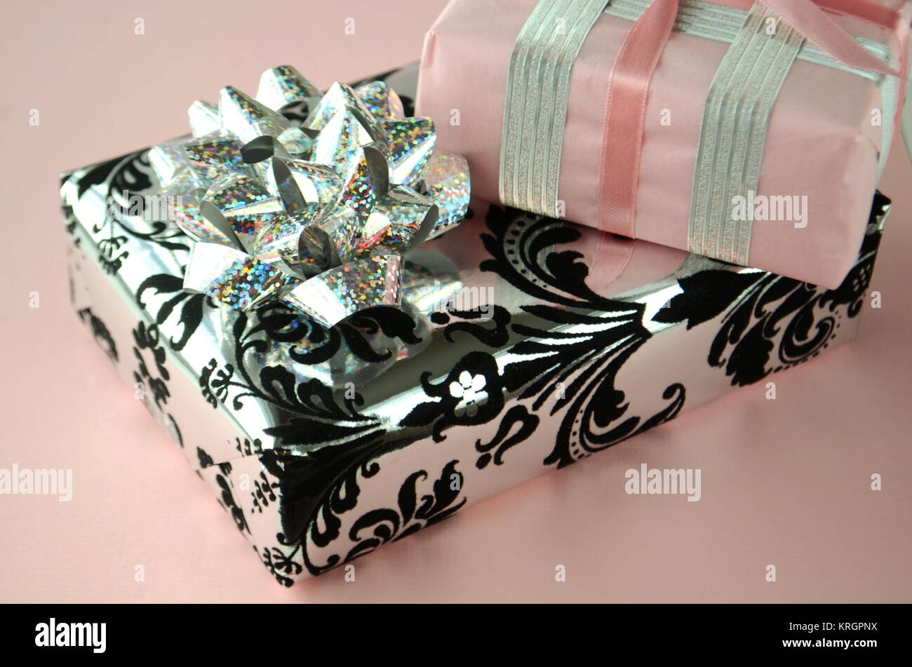 Gift wrapped presents beautiful gift boxes in luxurious wrapping gift wrapped presents beautiful gift boxes in luxurious wrapping paper on clean background with copy space celebrating birthdays and anniversaries negle Image collections