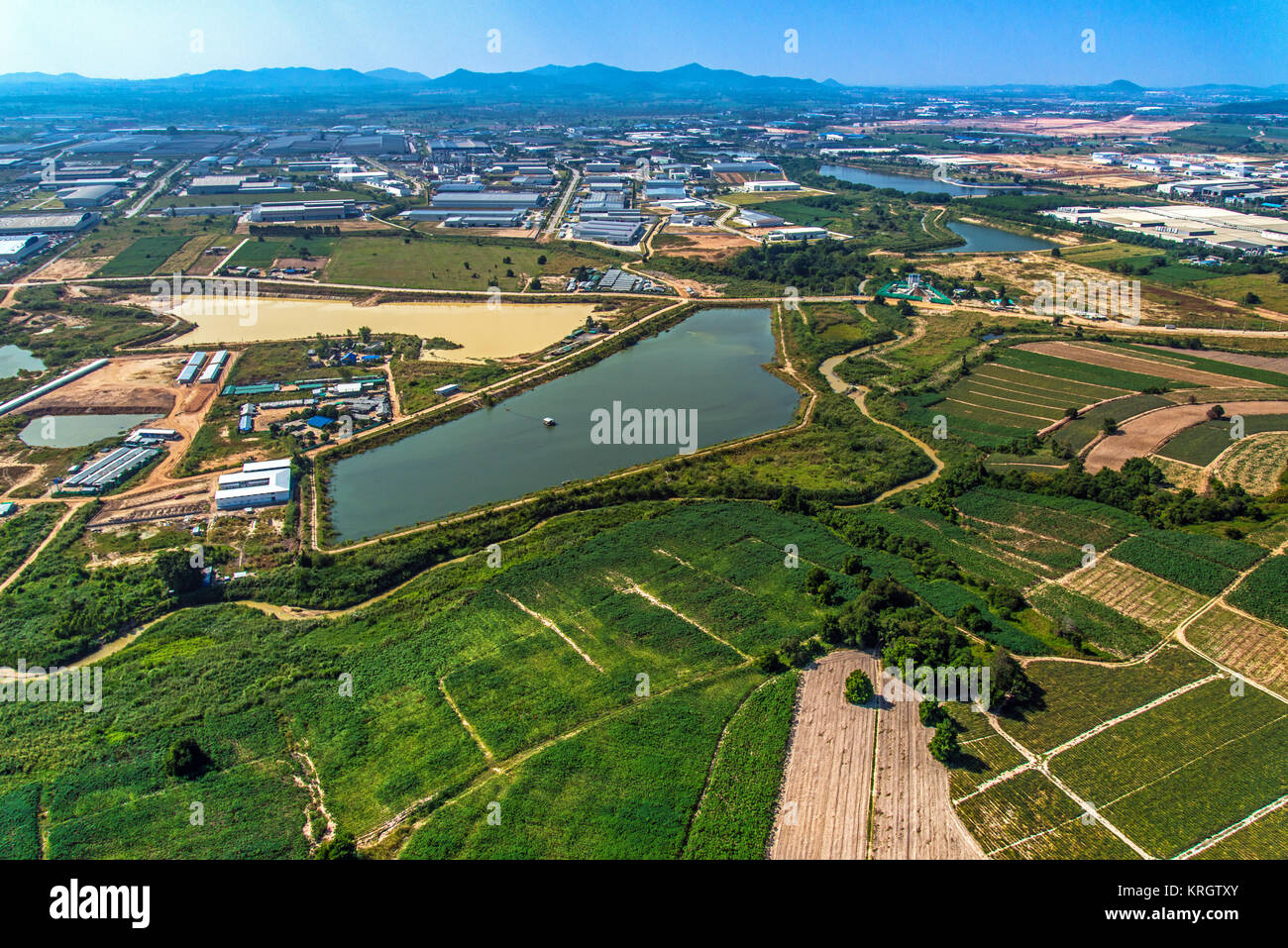 Industrial Estate Land Development Water Reservoir Farming aerial view - Stock Image