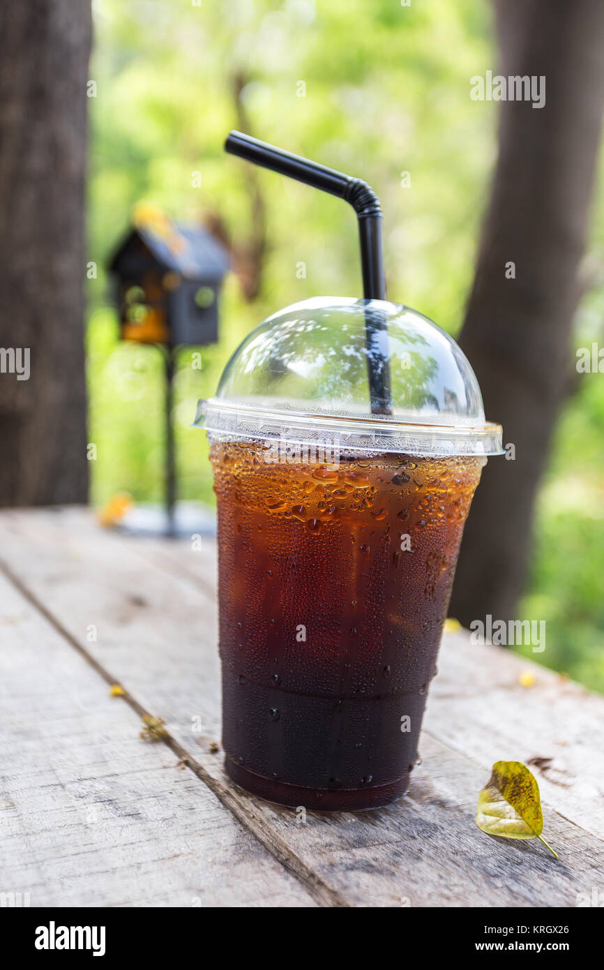 relax time with cold drink on wooden table lifestyle in nature - Stock Image