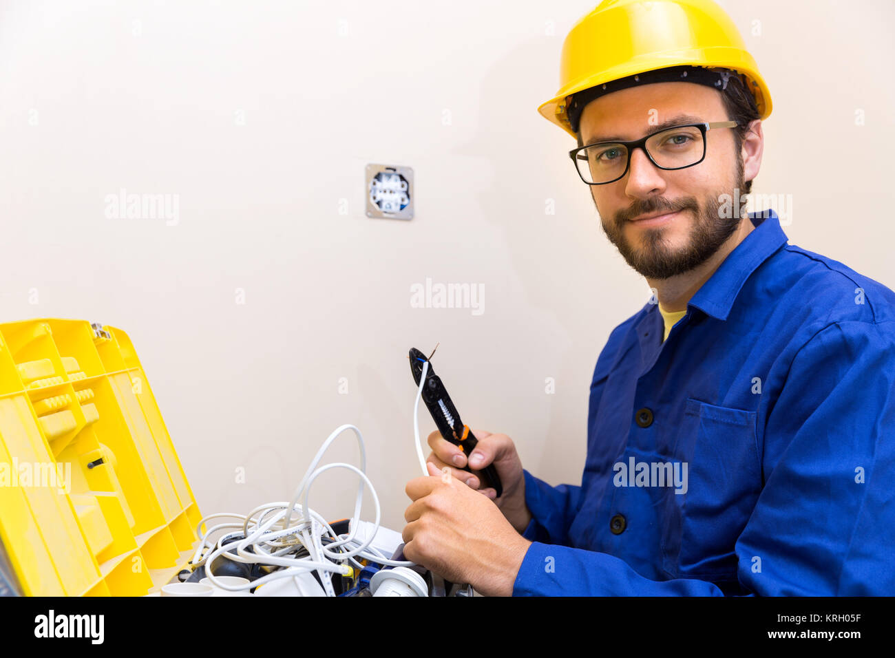 electrician occupation - worker and toolbox with electric accessories - Stock Image