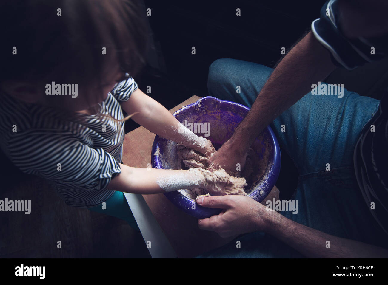 Father and daughter doing some dirty family cooking - Stock Image