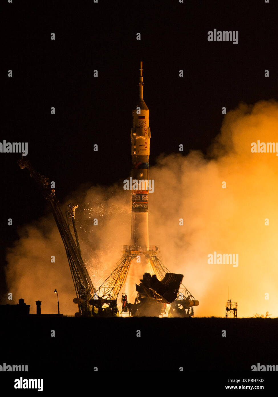 The Soyuz TMA-14M rocket launches from the Baikonur Cosmodrome in Kazakhstan on Friday, Sept. 26, 2014 carrying - Stock Image