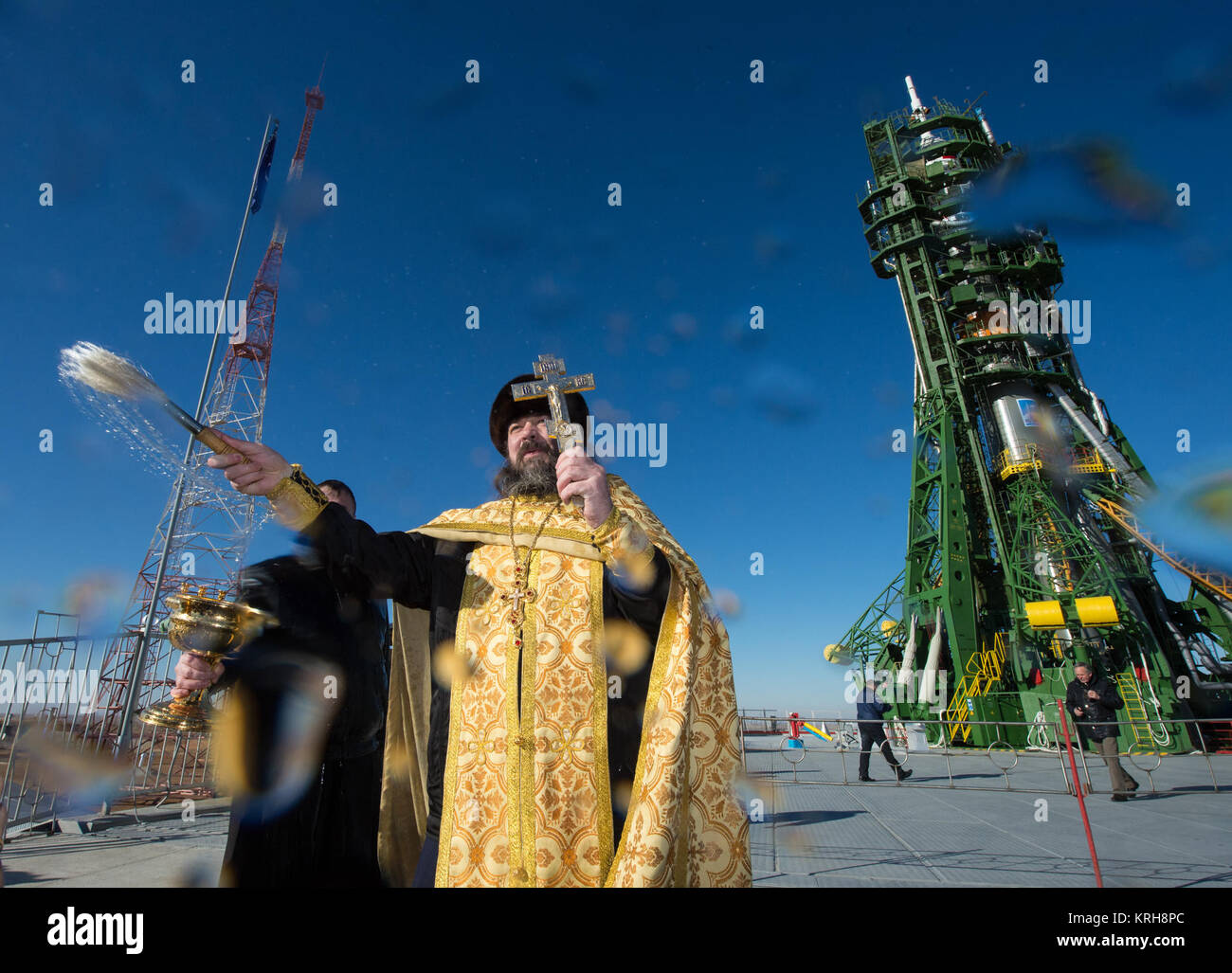 An Orthodox priest blesses members of the media at the Baikonur Cosmodrome launch pad on Saturday, Nov. 22, 2014, Stock Photo