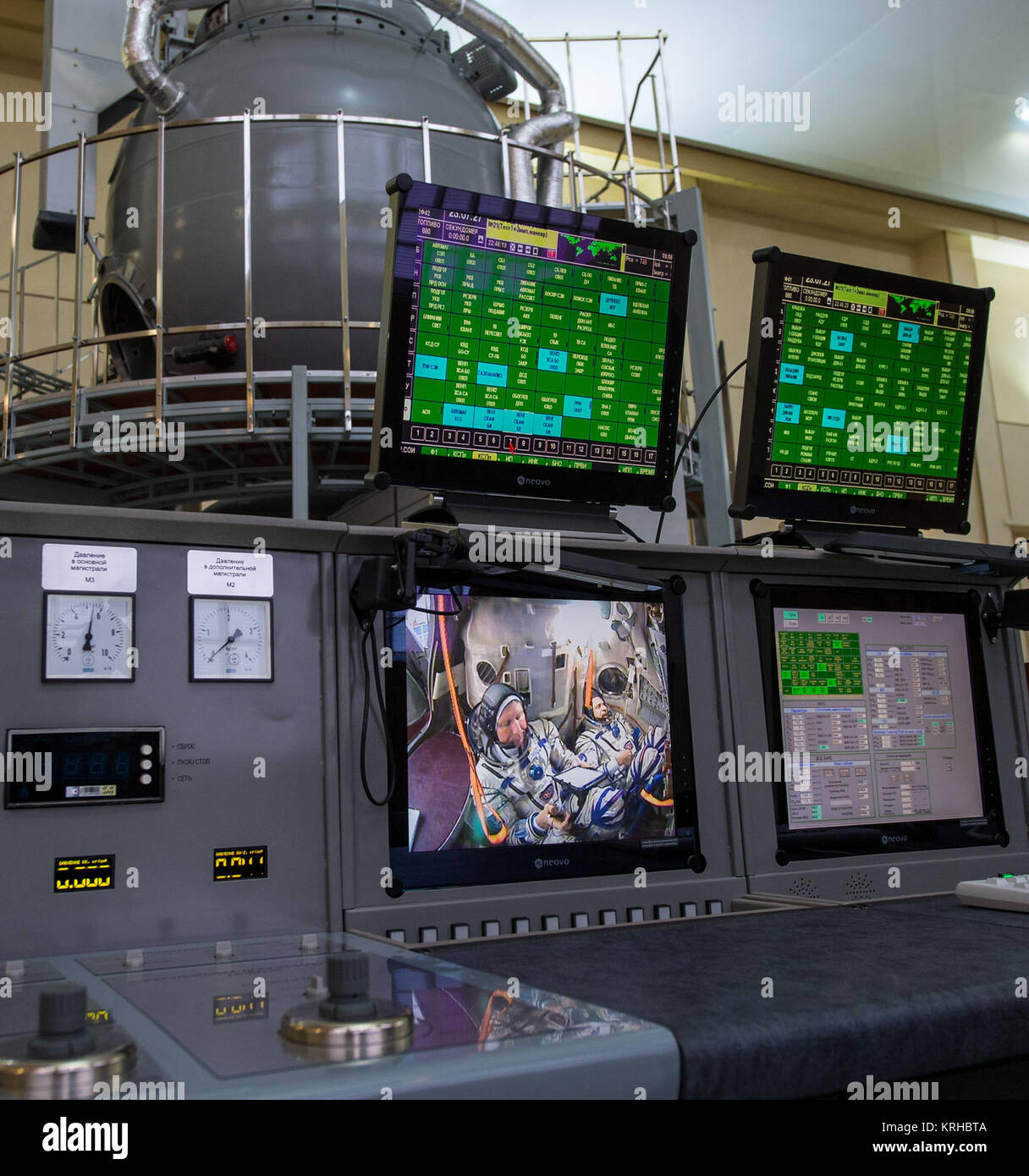 Expedition 43 Russian Cosmonauts Gennady Padalka of the Russian Federal Space Agency (Roscosmos), screen left, Mikhail - Stock Image