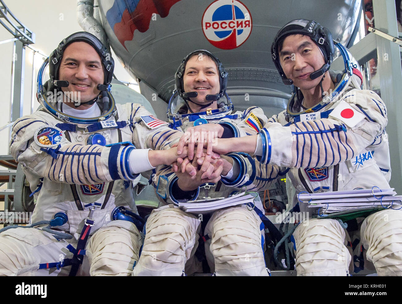 NASA astronaut Kjell Lindgren, left, Russian cosmonaut Oleg Kononenko, center, and Japan Aerospace Exploration Agency - Stock Image