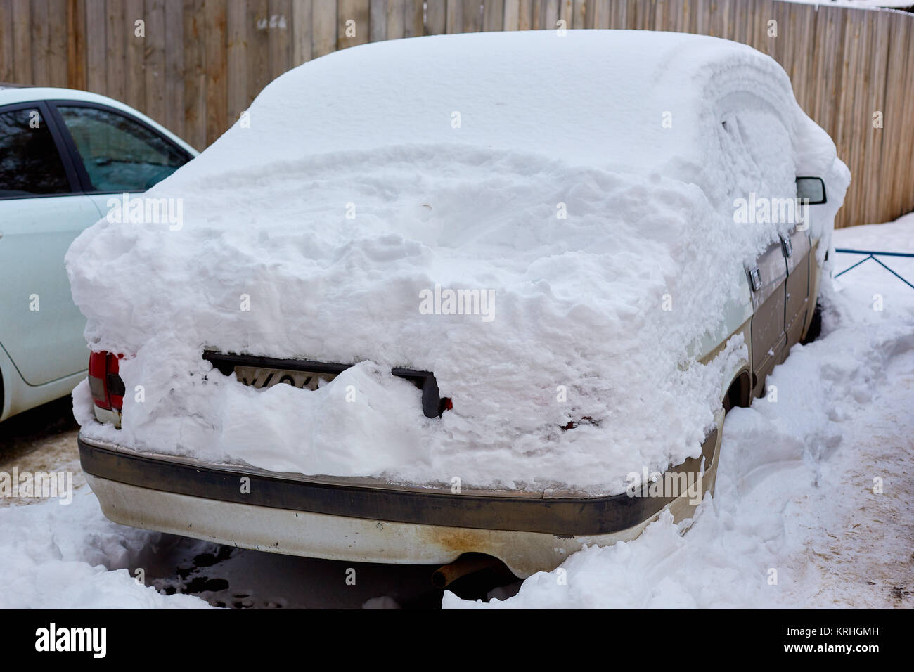 parked car covered with snow - Stock Image