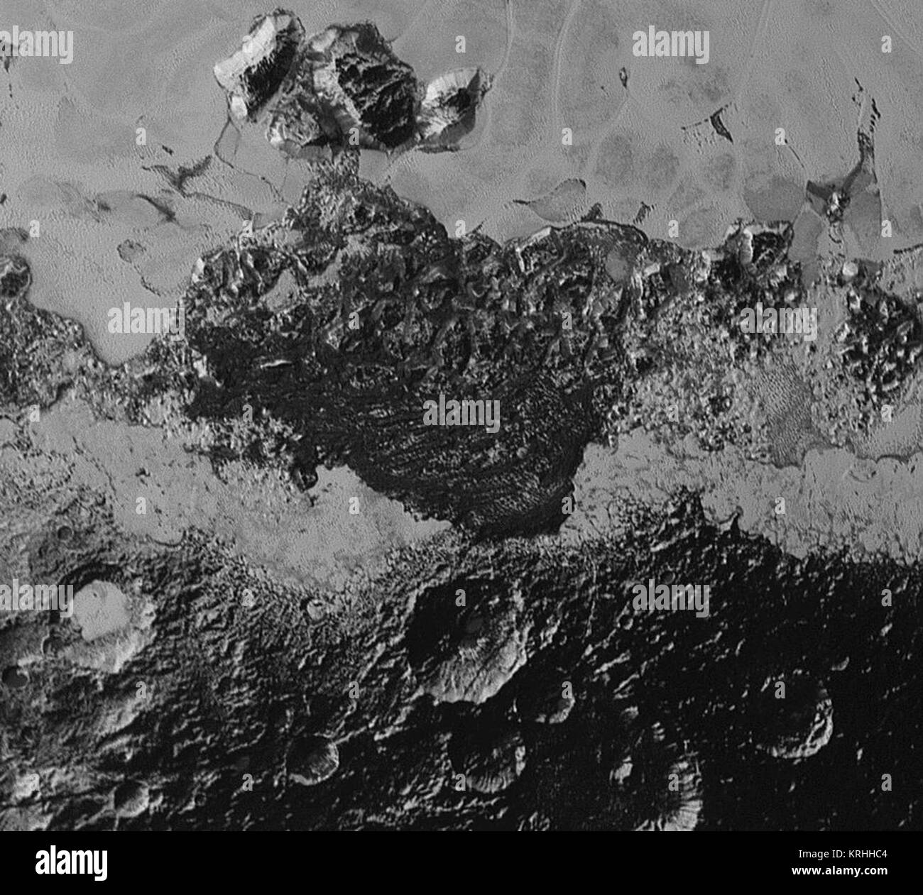 This 220-mile (350-kilometer) wide view of Pluto from NASA's New Horizons spacecraft illustrates the incredible - Stock Image