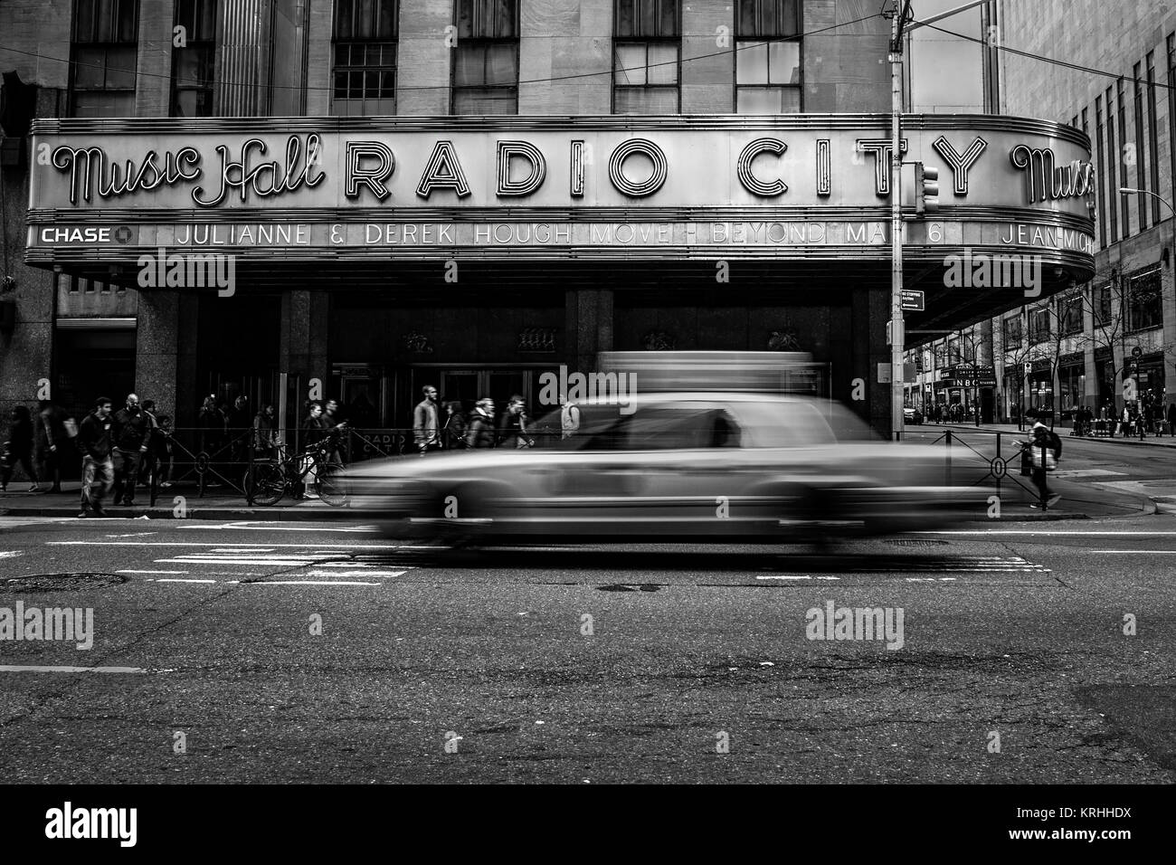 New York City Taxi Passes By Radio City Music Hall in New York City, America - Stock Image