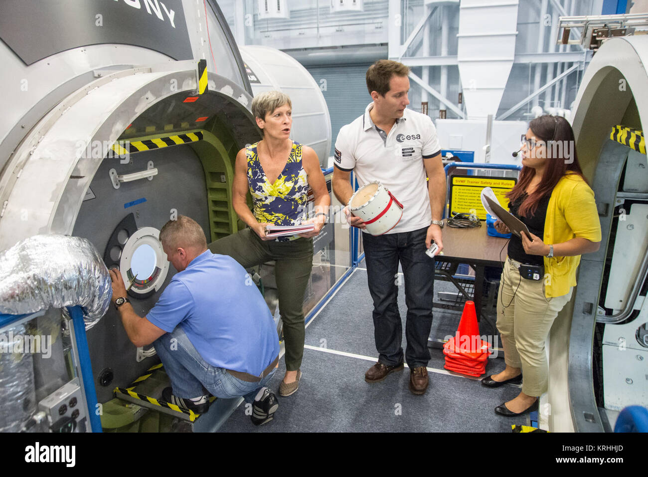 Date: 09-17-15 Location: Bldg 9NW, ISS Mockups Subject: Expedition 50/51 crew members Peggy Whitson, Thomas Pesquet, - Stock Image