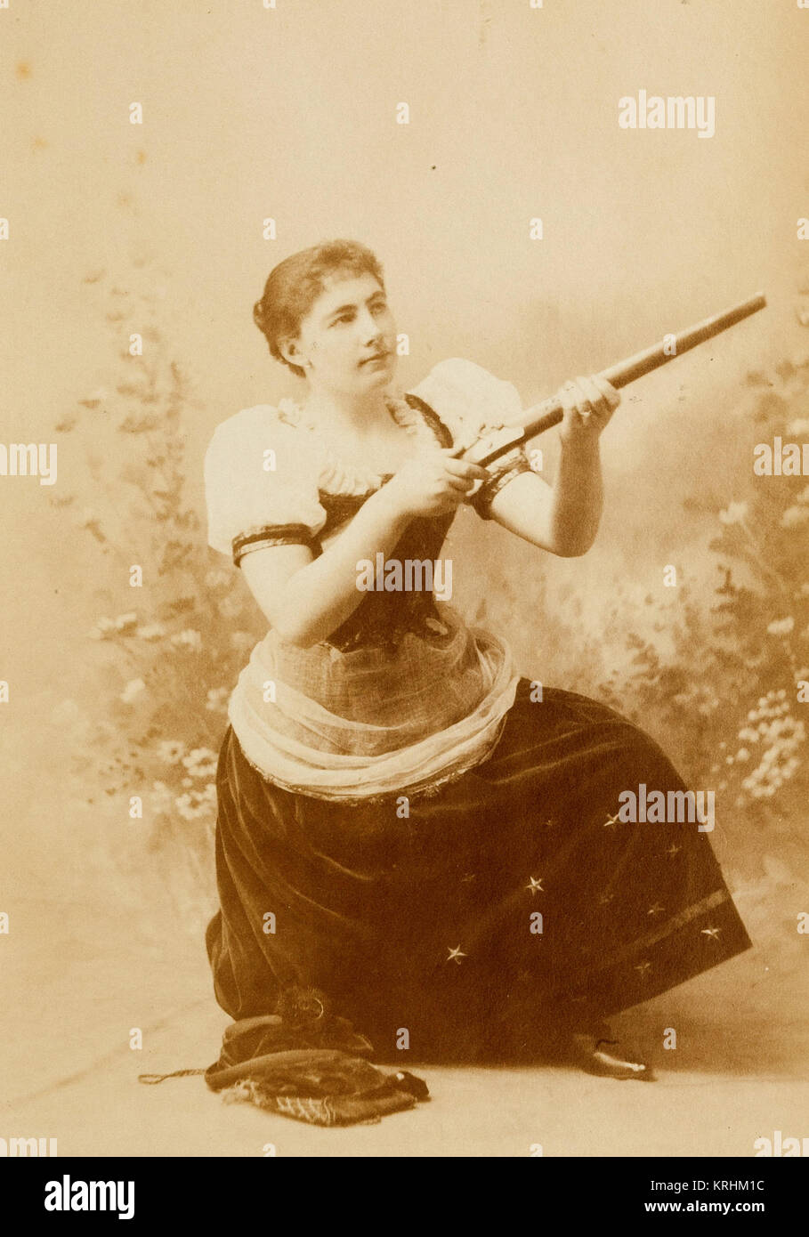 Cowgirl Poses With Rifle As A Supposed Sharpshooter - Stock Image