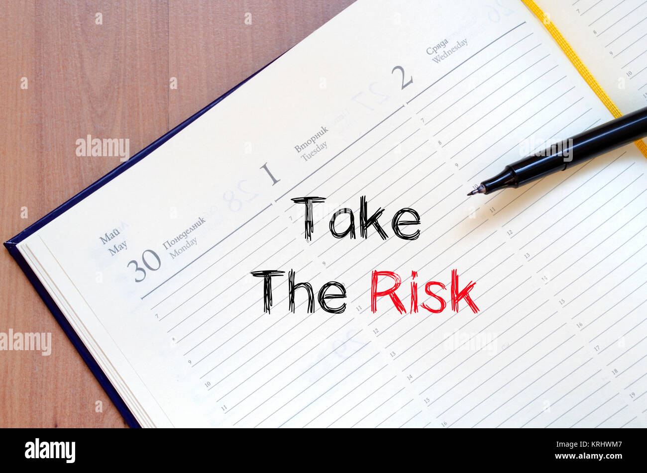 Take the risk text concept on notebook - Stock Image