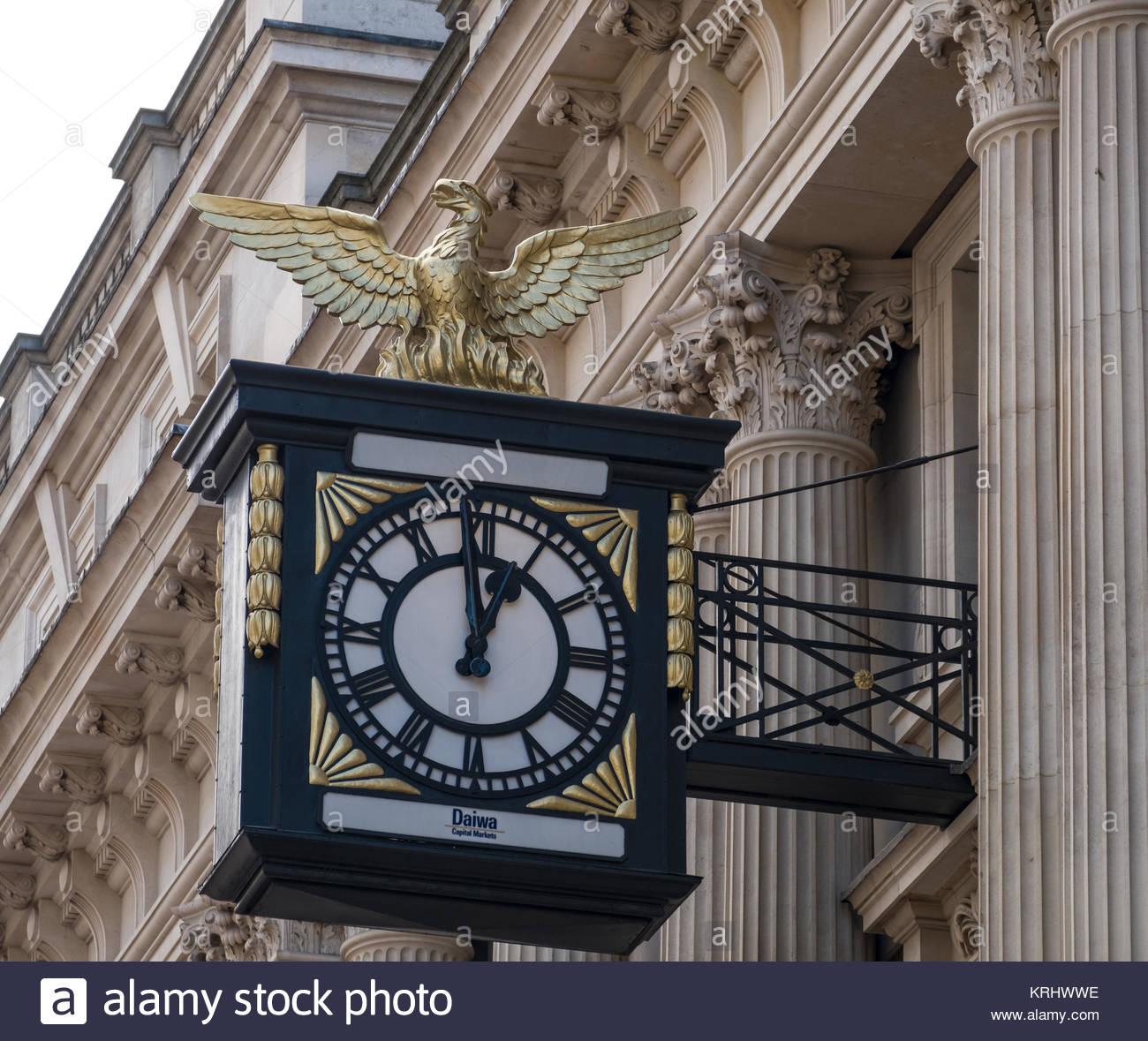 Gilded phoenix sculpture a symbol of the City of London on analog clock, King William Street, City of London, London, Stock Photo