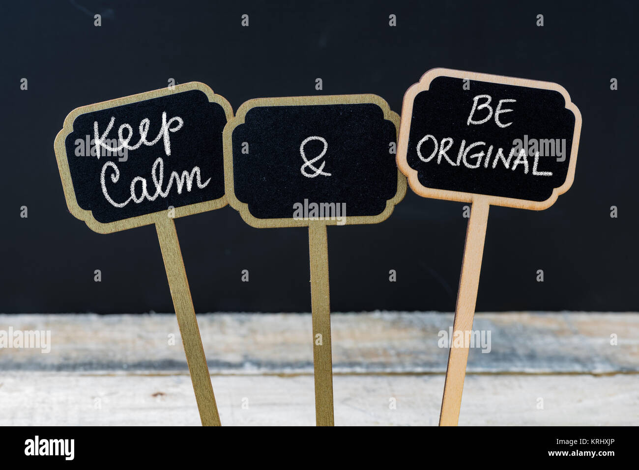 Keep Calm and Be Original message written with chalk on mini blackboard labels - Stock Image