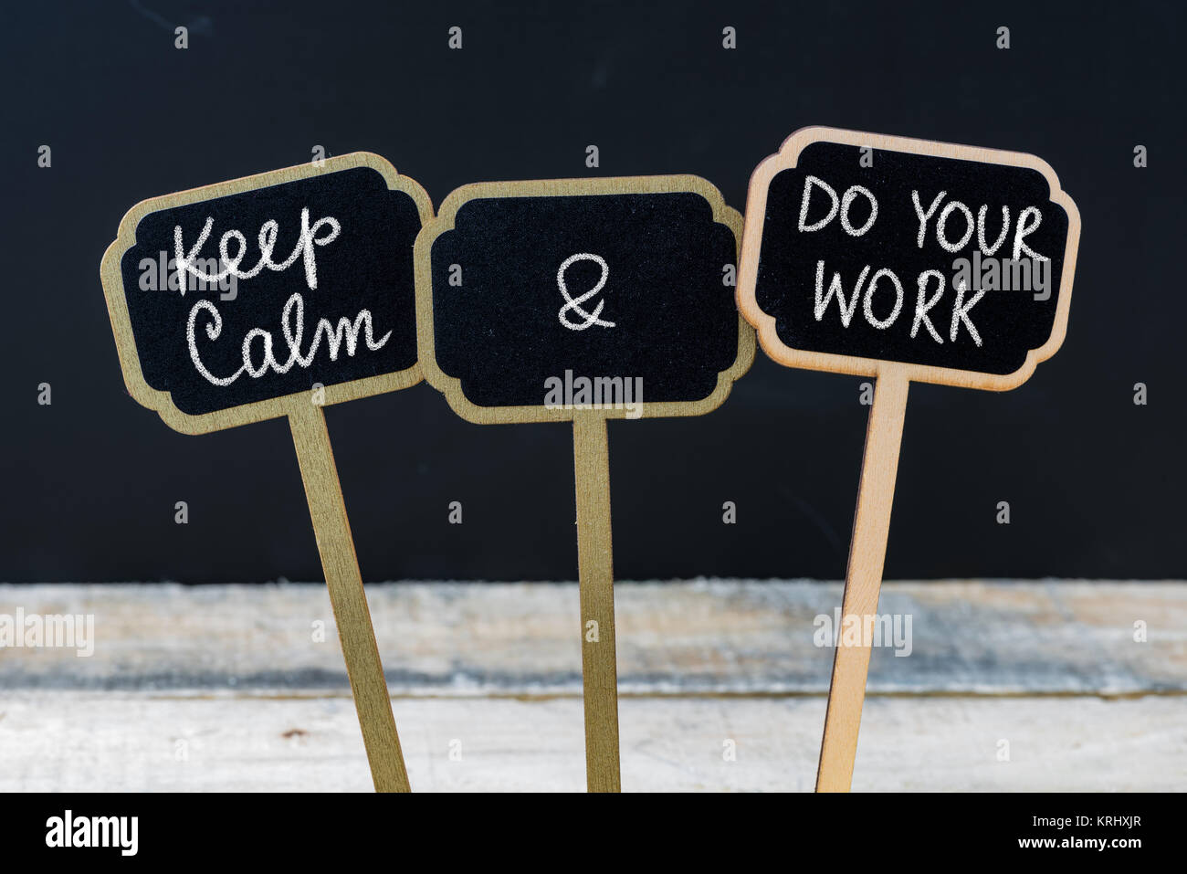 Keep Calm and Do Your Work message written with chalk on mini blackboard labels - Stock Image