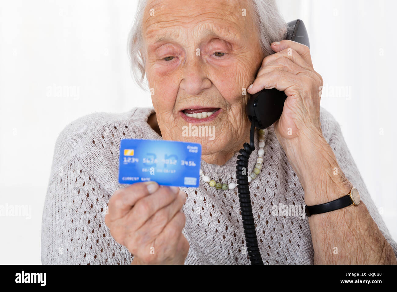 Senior Woman With Credit Card On Phone - Stock Image
