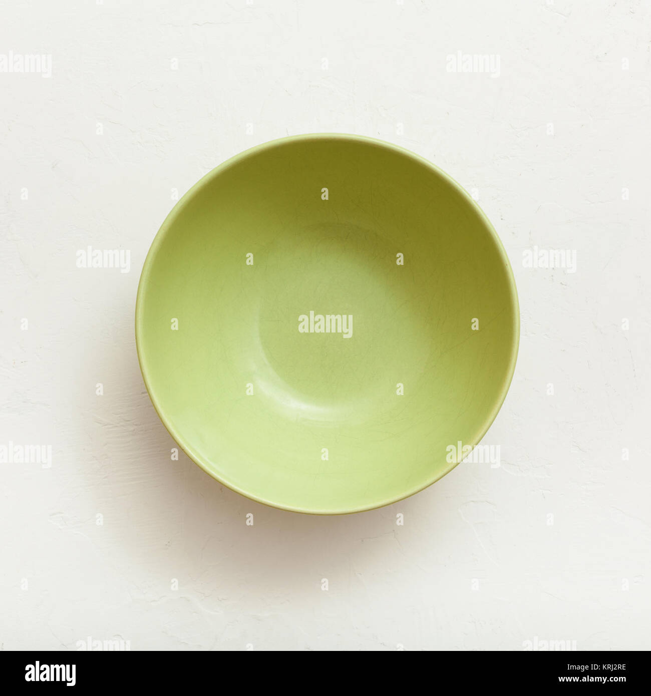 above view of green bowl on plastering plate Stock Photo