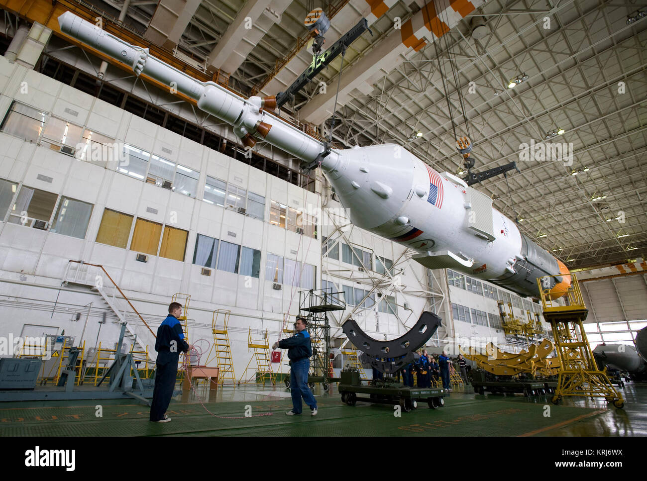 The escape tower, Soyuz TMA-14 spacecraft and third stage are moved for assembly to the first and second stages - Stock Image