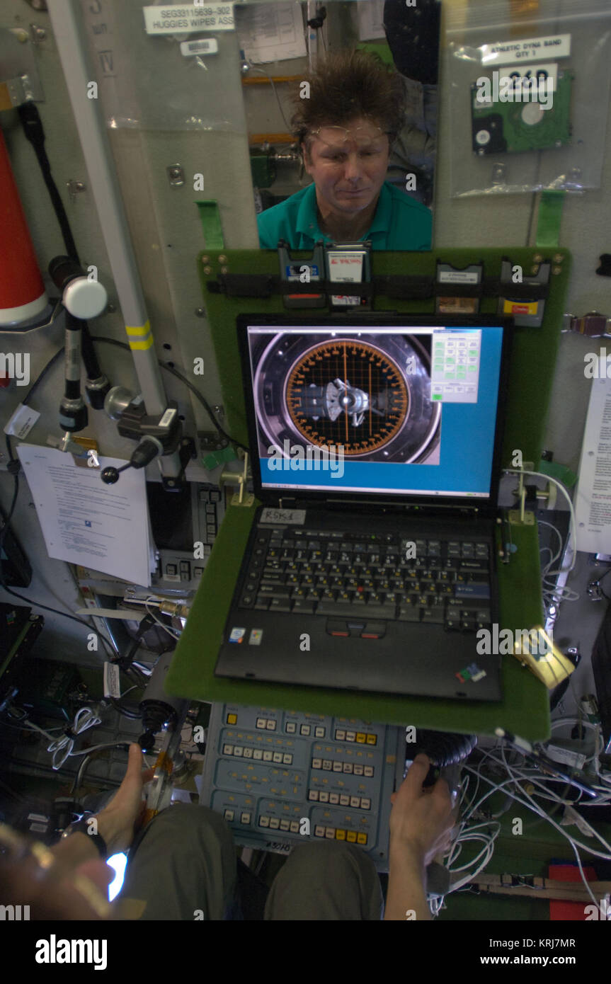 ISS-20 Gennady Padalka trains the relocation of the Soyuz TMA-14 spacecraft in the Zvezda Service Module - Stock Image