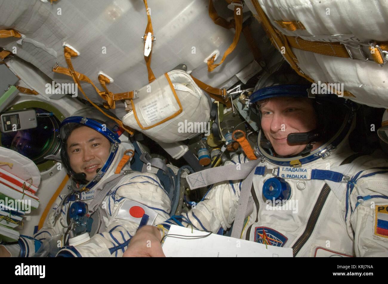 ISS-20 Koichi Wakata and Gennady Padalka in the Soyuz TMA-14 spacecraft - Stock Image
