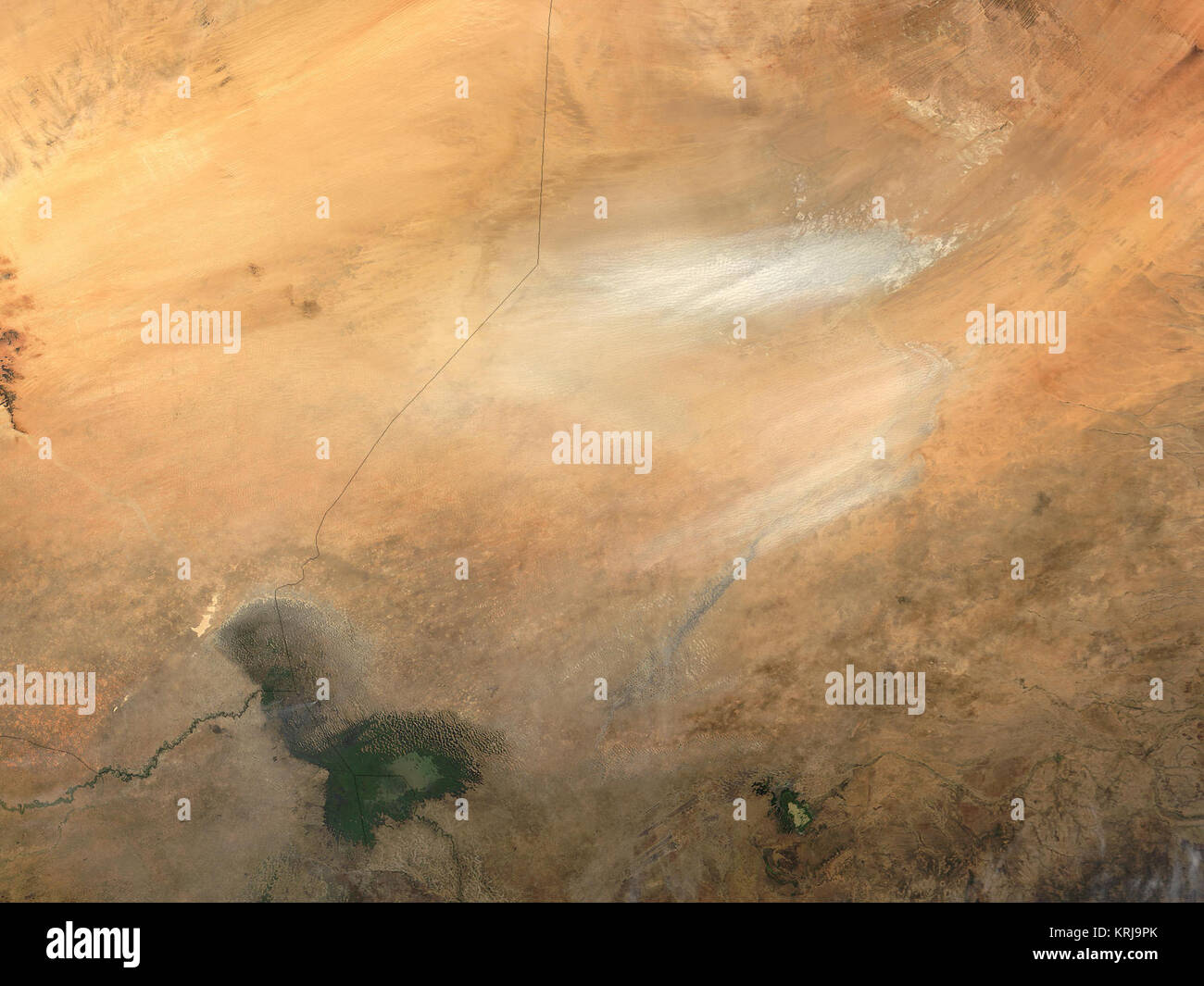 Dust from the Bodele depression in Chad, Africa (image right), is blowing across the Lake Chad region in this  modis.gsfc.nasa.gov - Stock Image