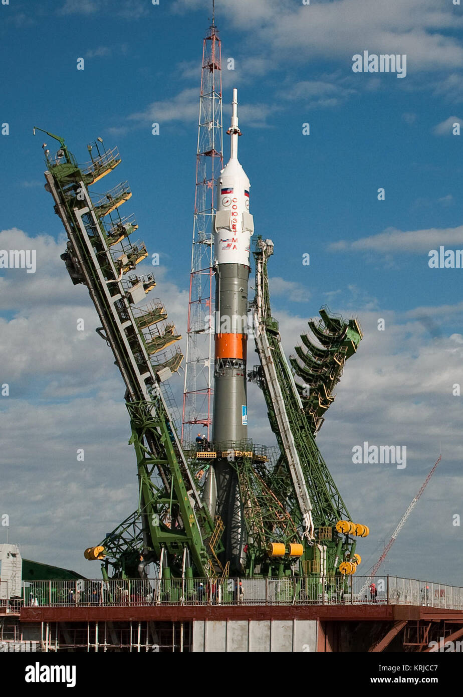 Launch scaffolding is raised into place around the Soyuz rocket shortly after arrival to the launch pad Tuesday, - Stock Image