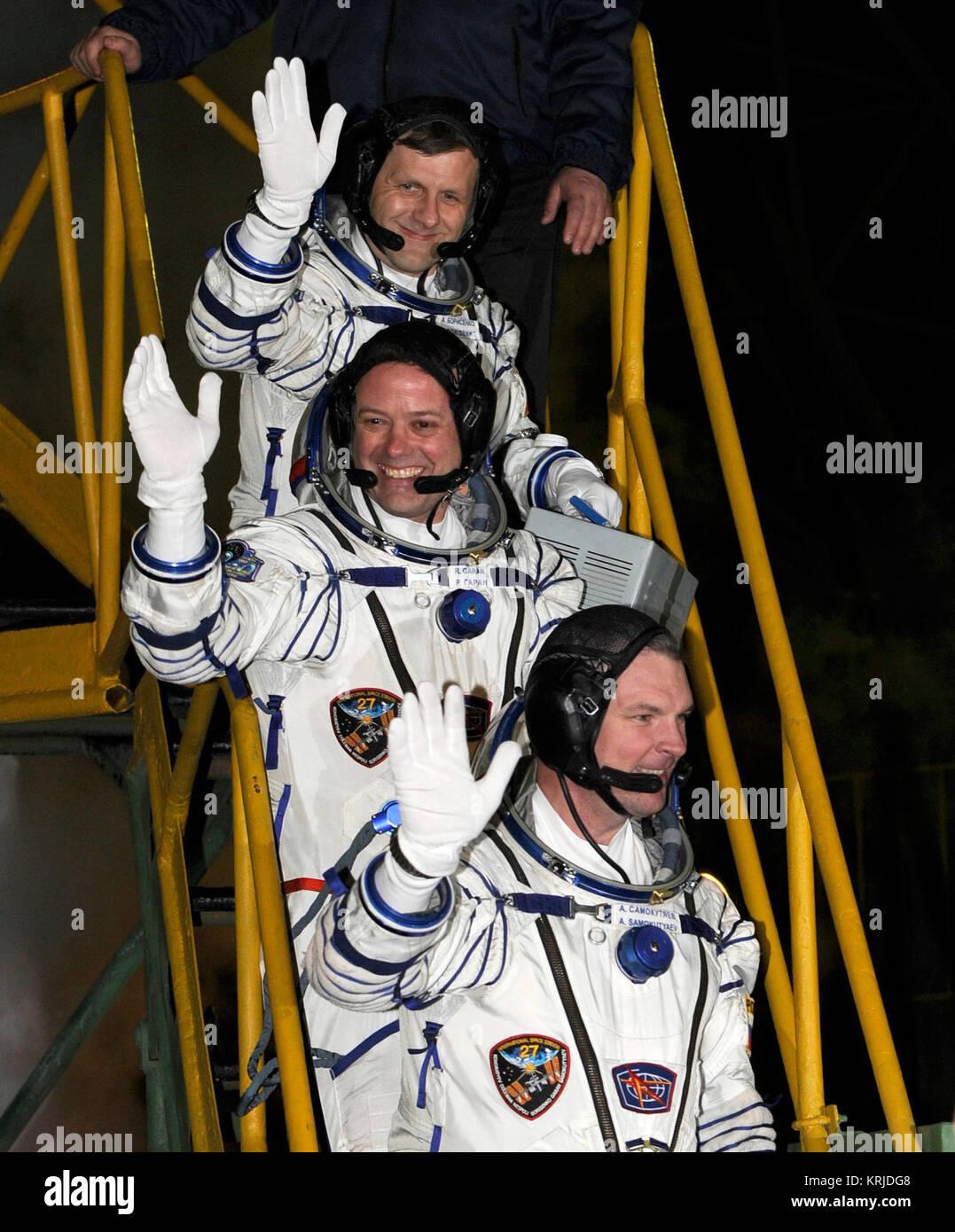 Expedition 27 crew members from top, Russian Flight Engineer Andrey Borisenko, NASA Flight Engineer Ron Garan, and - Stock Image