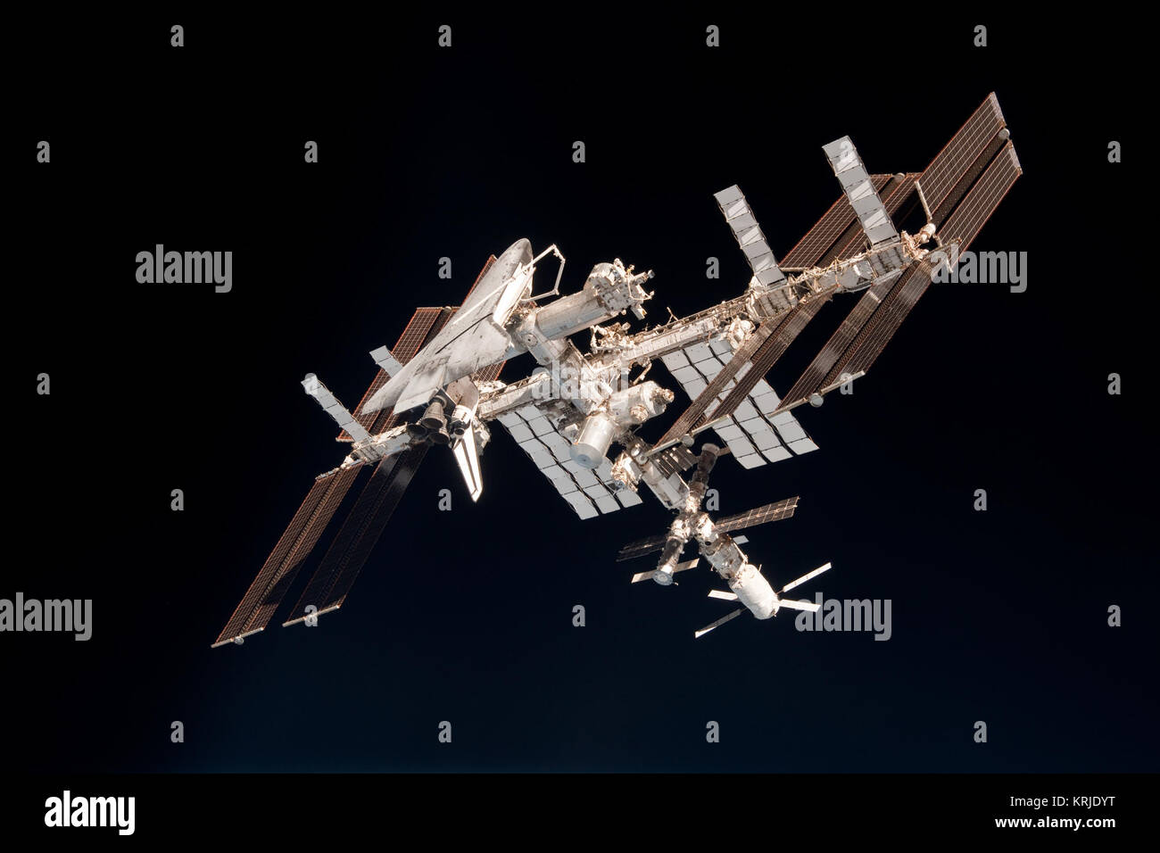 ISS and Endeavour seen from the Soyuz TMA-20 spacecraft 14 - Stock Image