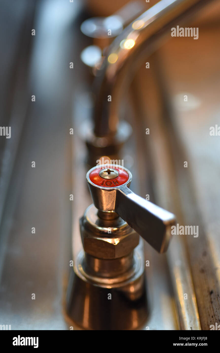 Hot faucet tap - Stock Image