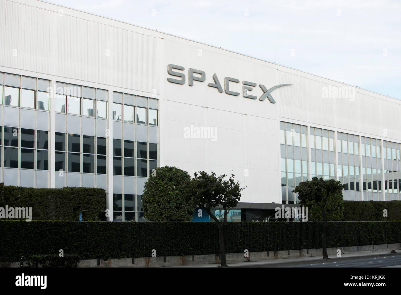 A logo sign outside of the headquarters of Space Exploration Technologies Corp., also known as SpaceX, in Hawthorne, - Stock Image