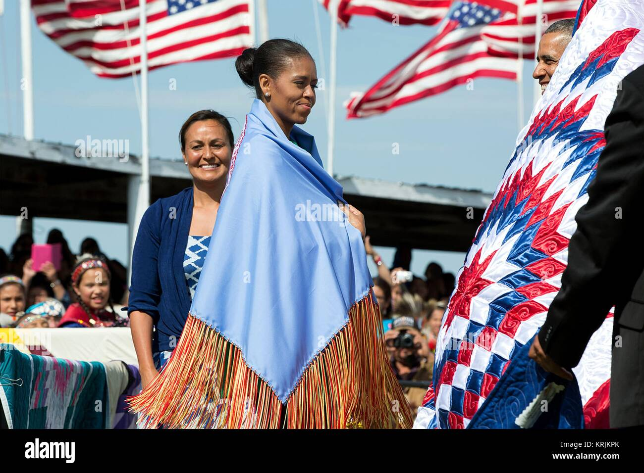U.S. First Lady Michelle Obama wears a shawl presented to her by Native American Tribe Chairman Dave Archambault - Stock Image