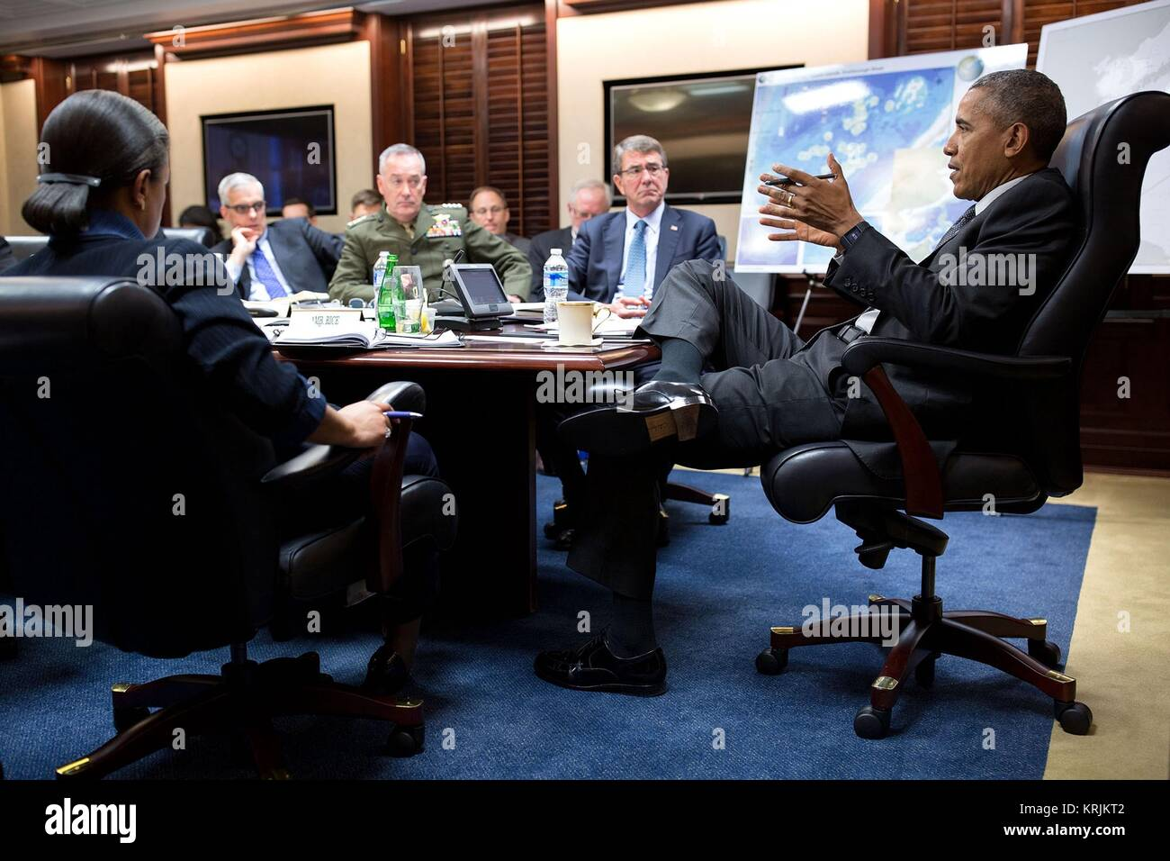 U.S. President Barack Obama meets with the National Security Council at the White House Situation Room March 18, - Stock Image