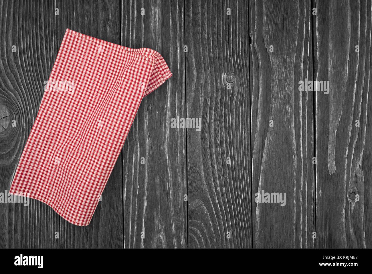 cloth napkin on wooden background - Stock Image