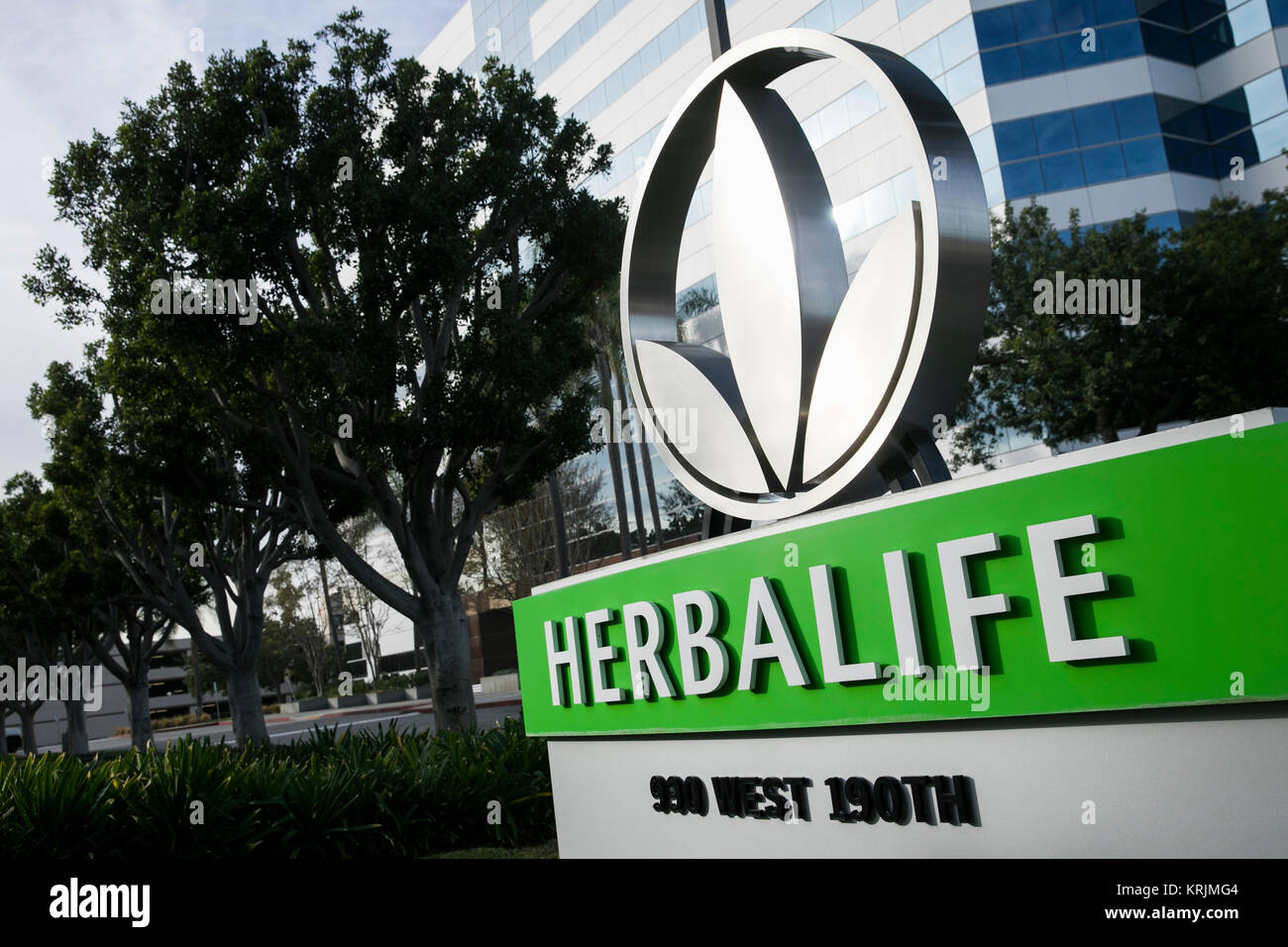 A logo sign outside of a facility occupied by Herbalife