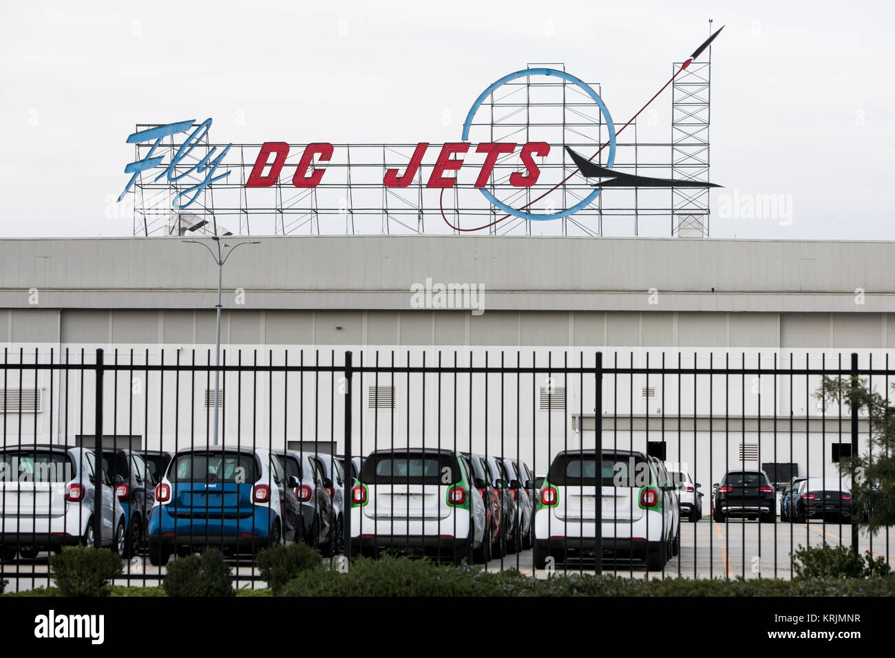 A 'Fly DC Jets' neon logo sign outside of the former Boeing 717 Jet Aircraft factory in Long Beach, California, - Stock Image