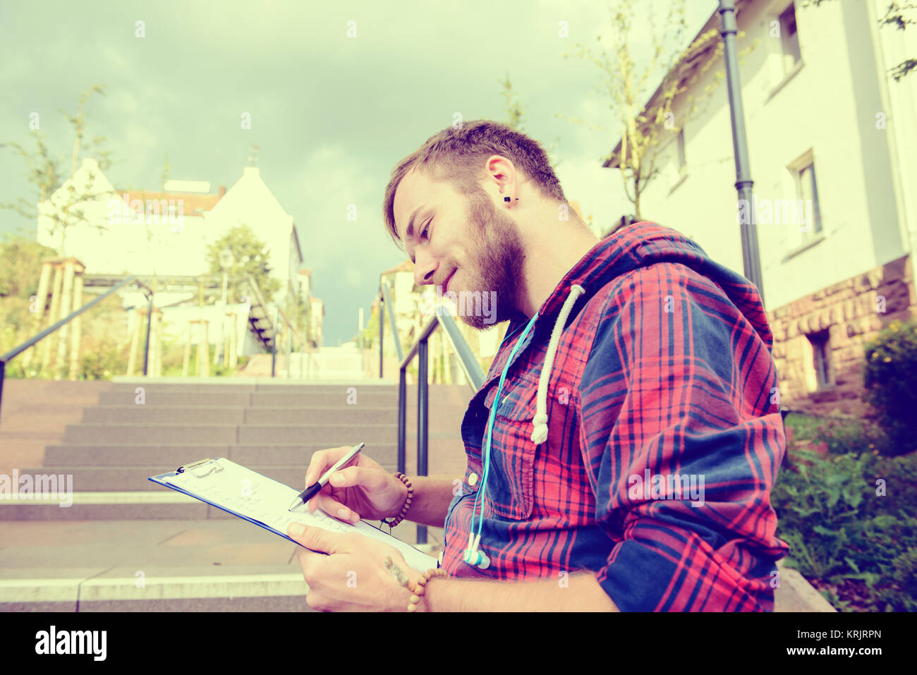 young man is reading a book - Stock Image
