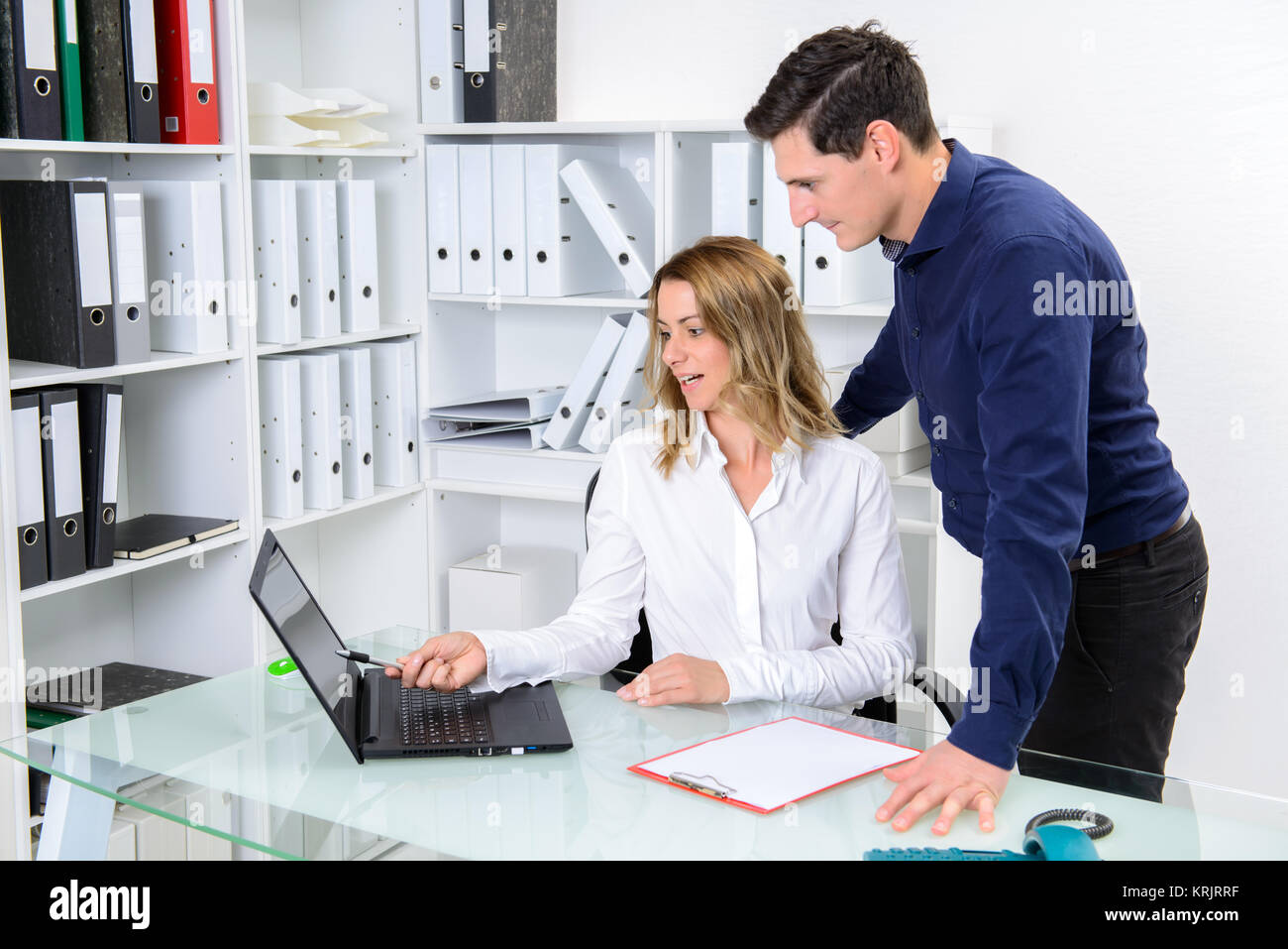 businessman and businesswoman working together in the office - Stock Image